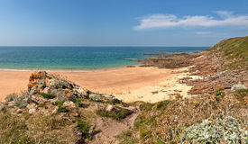Rough rocky coastal panoramic landscape of Brittany with blue sky. Stock Photography