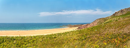 Rough rocky coastal panoramic landscape of Brittany with blue sky. Stock Photos