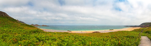 Rough rocky coastal panoramic landscape of Brittany with cloudy sky. Royalty Free Stock Photo