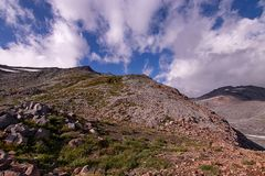 rough rocky mountain landscape below a bright blue sky royalty free stock photography
