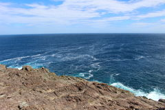 A Rough Rocky Outcrop in the Atlantic Royalty Free Stock Images
