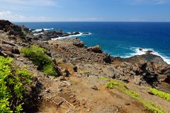Rough and rocky shore at south coast of Maui, Hawaii. USA Stock Photos
