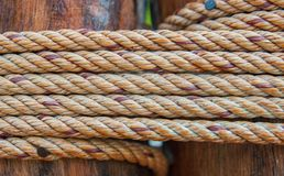 Rough rope on wood Stock Images