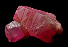Red Sri Lanka gemstone. Rough Ruby from Ratnapura mining area in Sri Lanka Royalty Free Stock Photography