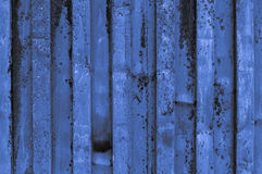Rough and rusty blue light grayish bluish indigo corrugated iron. Metal surface close-up. Fine artistic backgrounds of almost gray resulting from various rough Royalty Free Stock Image