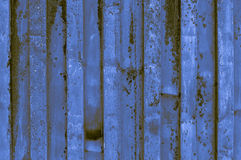 Rough and rusty blue yellowish brownish indigo corrugated iron m. Etal surface close-up. Fine artistic backgrounds of almost gray resulting from various rough Stock Images
