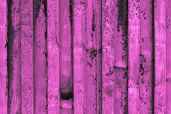 Rough and rusty purple pink or purplish pinkish violet corrugate. D iron metal surface close-up. Fine artistic backgrounds of almost gray resulting from various Stock Photo