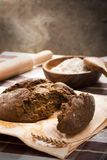 Rough rye bread. Cracked rough rye rural bread Stock Images