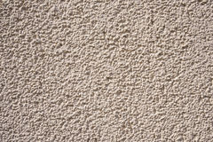 Rough sand colored wall. Rough texture sand colored wall backgorund Stock Photo