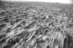 Rough sand ground. Black and white. Rocky, rough, sandy ground Stock Images
