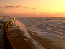 Rough Sea. Promenade with rough sea at dusk royalty free stock photography