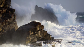 Rough Sea. Rugged coastline takes a battering by a king wave Royalty Free Stock Photo