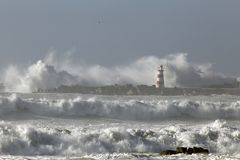 Rough sea with big waves. Rough sea with big stormy waves. Northern portuguese coast. Entry of Povoa do Varzim and Vila do Conde harbor Stock Images