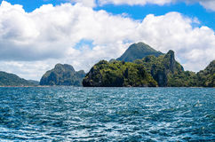 Rough sea, Cadlao island, el nido on Background, Palawan, Philippines. Rough sea by Cadlao island. El-nido on Background, Palawan, Philippines Stock Photography