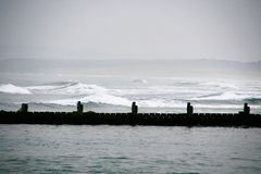 Rough sea and causeway Stock Image