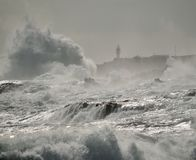 Rough sea, big waves and lighthouse Stock Image