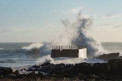 Rough sea coastline wave splash danger pier shore Royalty Free Stock Image