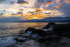 Rough Sea, Croatia. Rough Adriatic Sea, by The Beach in Rijeka, Croatia, with beautiful Sunset over The Sea and Mountains, photographed at Winter afternoon royalty free stock photography