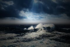 Rough sea and dark sky. Rough sea and dark clouds with rays of sun. Picture taken at the ocean stock photography