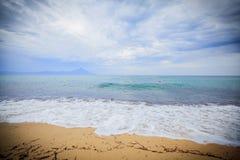 Rough sea dramatic sky. Rough sea , sand beach , dramatic sky Stock Image