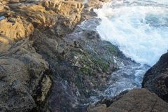 Arraial of cabo Rough sea with hangover strong winds and waves crashing on rocks. N royalty free stock image