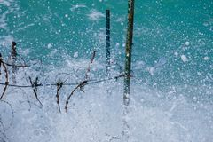 Rough sea and high waves. Crashing on shore abstract water barbed wire danger ocean splash warning windy stock photos