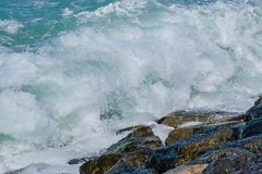 Rough sea and high waves. Crashing on shore aginst rocks boulder boulders danger ocean warning windy royalty free stock photography