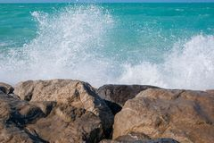 Rough sea and high waves. Crashing on shore aginst rocks royalty free stock photo