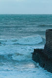 Rough Sea and Jetty at Dusk Royalty Free Stock Photography