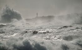 Rough sea and lighthouse background Stock Photo