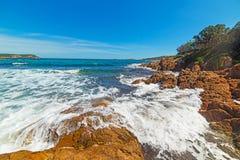 Rough sea in Piccolo Pevero beach. In Costa Smeralda, Italy Royalty Free Stock Images