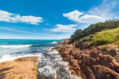 Rough sea in Piccolo Pevero beach. In Costa Smeralda, Italy Stock Photography