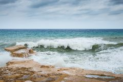 Rough sea on the rocky Coast of Gozo royalty free stock photography