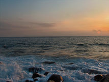 Rough sea at sunset Stock Photography