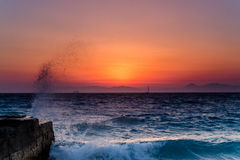 Rough sea. Sunset over rough Aegean sea royalty free stock photo