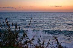 Rough sea at sunset Stock Image
