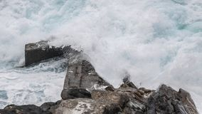 Rough sea. View on the rocks and the rough sea waves in the bay of San Sebastian Basque country Spain Royalty Free Stock Photo