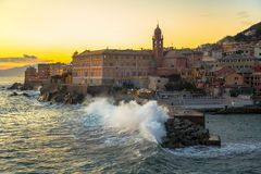 Rough sea in the village of Nervi, at sunset, Genoa, Italy. royalty free stock images