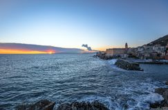 Rough sea in the village of Nervi, at sunset, Genoa, Italy. royalty free stock image