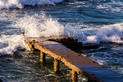 Rough Sea Waves Crashing On Old Pier Stock Photography