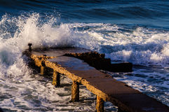Rough Sea Waves Crashing On Old Pier Royalty Free Stock Photos
