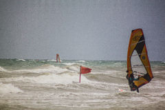 Rough sea with windsurfist, Italy Royalty Free Stock Image