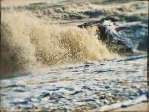 Rough sea on a winter day. Big waves crashing on the beach Stock Photography