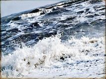Rough sea on a winter day. Big waves crashing on the beach Stock Images