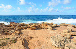 Rough sea and yellow rocks Royalty Free Stock Image