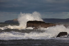 Rough Seas. At Holyhead Breakwater with waves crashing over the rocks Royalty Free Stock Photo