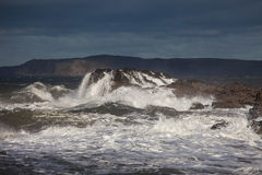 Rough Seas. At Holyhead Breakwater with waves crashing over the rocks Royalty Free Stock Photos