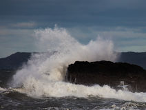 Rough Seas. At Holyhead Breakwater with waves crashing over the rocks Stock Image