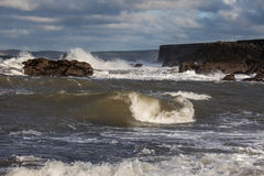 Rough Seas. At Holyhead Breakwater with waves crashing over the rocks Royalty Free Stock Images