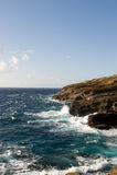 Rough seas. Slamming against a rocky shoreline Royalty Free Stock Photos